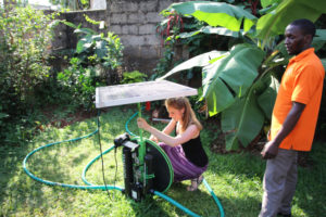 GSSE student installing solar panels