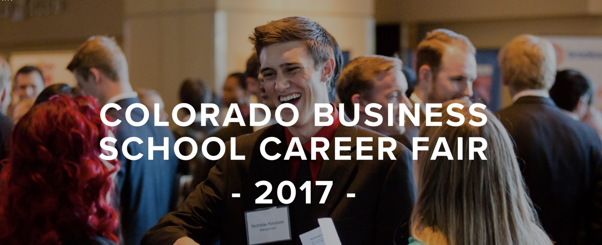 A business student enjoyin the Colorado Business School Career Fair