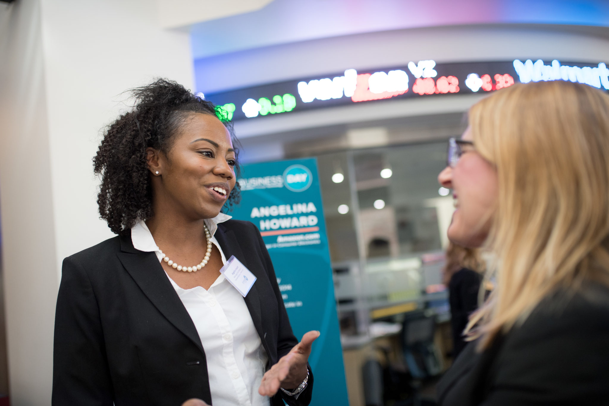 Angelina Howard talks to people during Business Day