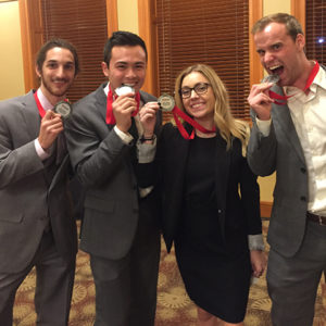 Four Supply Chain Students show off their 2nd place medals.