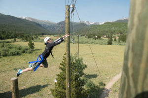 Global Business Academy students jumps into the air at CSU's Mountain Campus