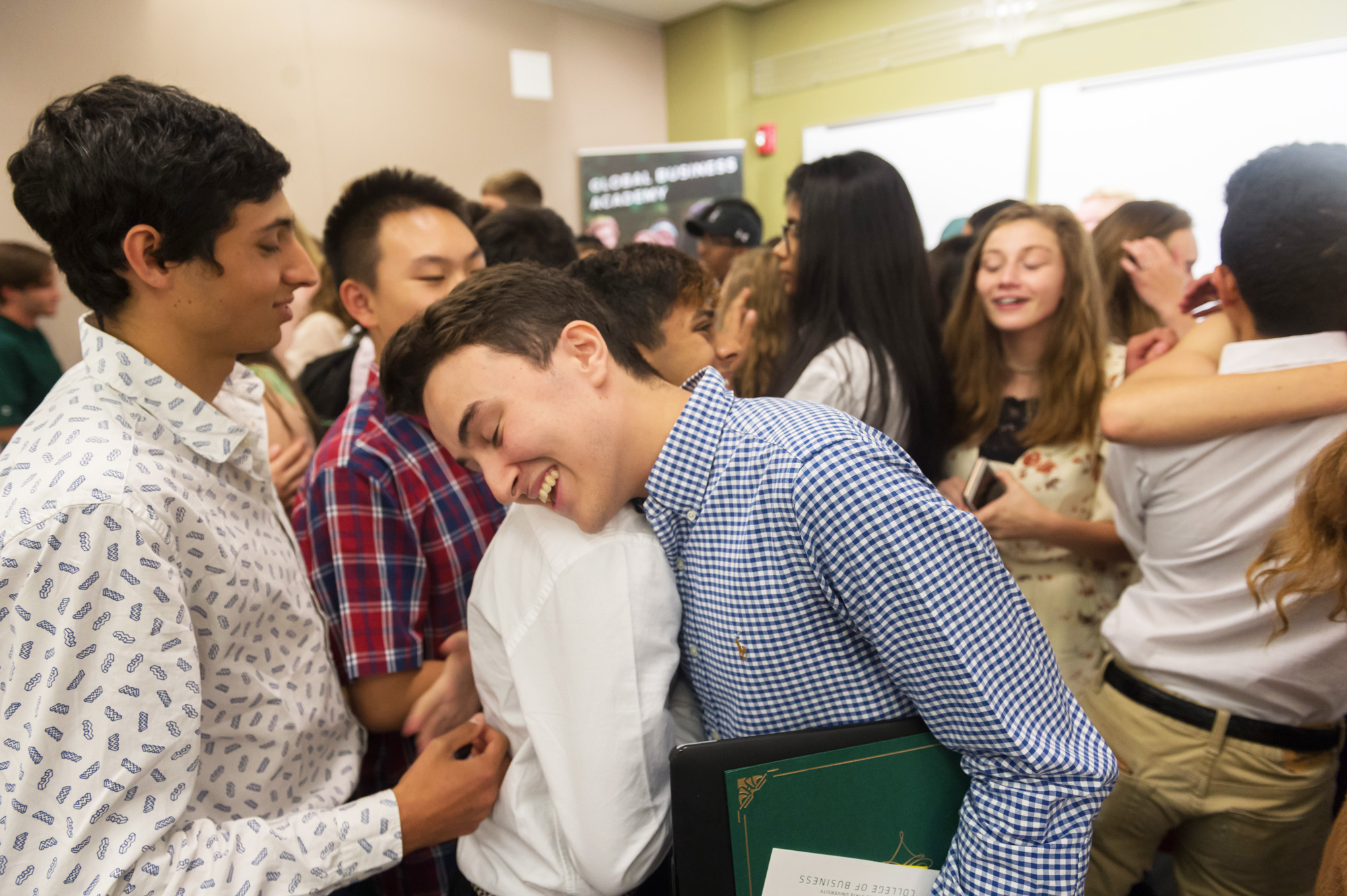 Global Business Academy students hug goodbye