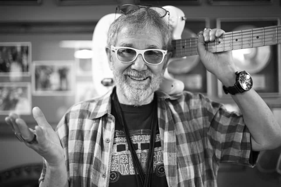 Chuck Morris with guitar over shoulder