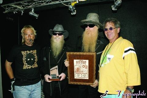Chuck and ZZ Top signing a poster from Tulagi