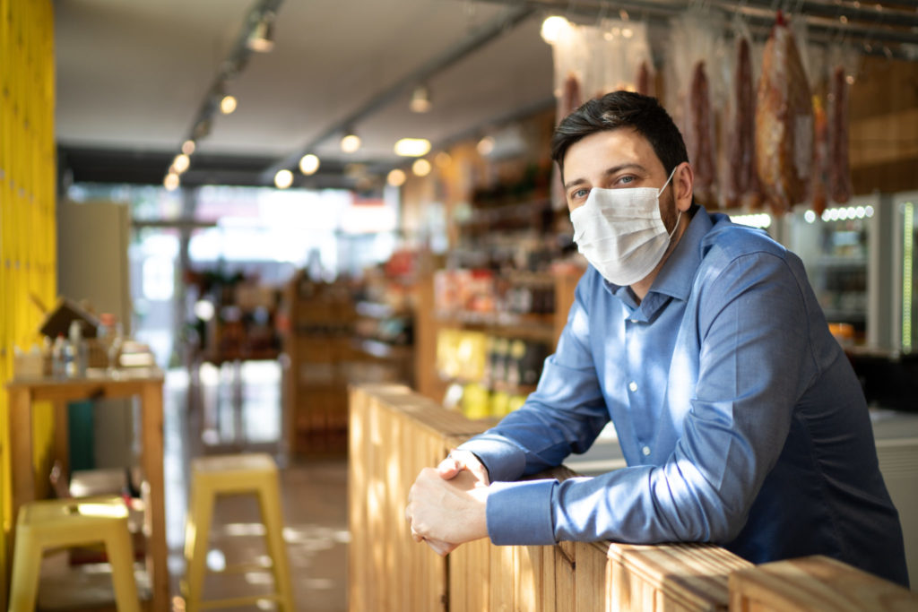 Business owner wearing a face mask