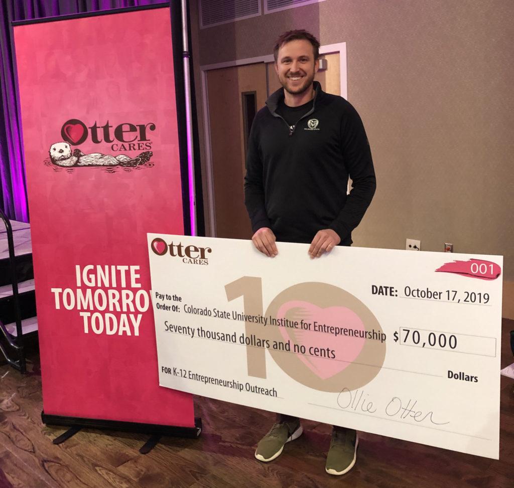 Institute for Entrepreneurship Director Scott Shrake receives a $70K check from OtterCares