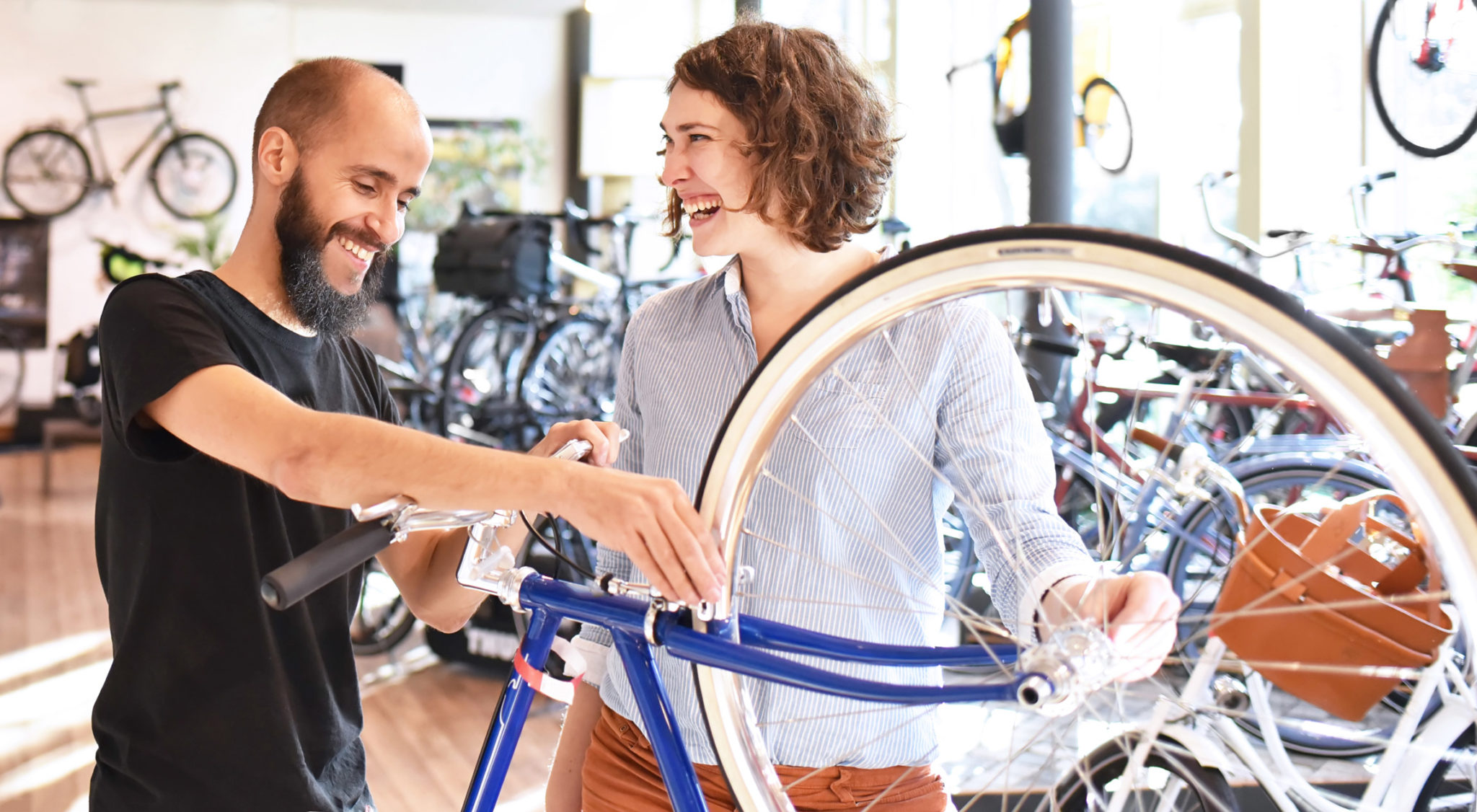 A salesperson helps a customer purchase a bike